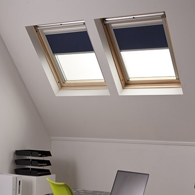 Two Navy Skylight Blinds in roof windows side by side